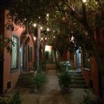 The view from inside the courtyard looking out at night