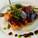 Miso Brushed Salmon with parsnip purée, braised vegetables, red wine reduction and petit watercr