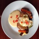 Baked Potato, grilled Veggies with a nice creamy cheese sauce
