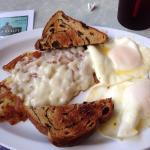 2 eggs, hash browns with onions and provolone cheese and raisin toast. Yum!