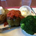 Stuffer pepper with sides of baked potato and broccoli