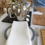 Highly polished tea and coffee pots. With a hot water refill pot. Proper cotton napkins too.