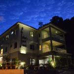Father's Guest House at night