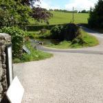 Corner post box and view of the road and bridge