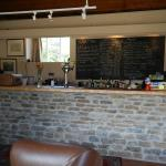 Pub counter and food menu on the chalkboard behind the bar