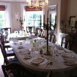 Dining room set up for a dinner party Photo 1