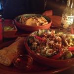 Nachos con carne, goat cheese salad and Corona!