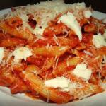Penne pesto alla Siciliana with delicately placed fresh mozzarella