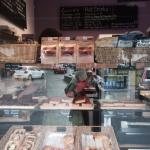 The front of the shop and the sausage rolls, tarts and flapjacks in the window.