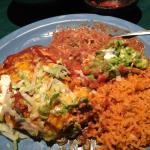 Green chili relleno, beans and rice with guacamole and sour cream.