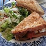 Bacon and (fried) egg sandwich served with caesar salad