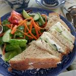 Cream cheese and cucumber sandwich served with a garden salad