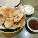 Pita bread served with garlic dip and salsa