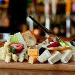 Artisan Cheese Platter appetizer with crostini and assorted fruit