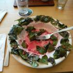 wilted spinach on edge of salad plate