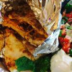 Pork Quesadilla with lettuce, pico and sour cream