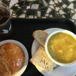 Homemade chicken soup and fresh baked croissant