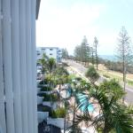 View from balcony overlooking pool & ocean