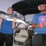 Daughter gets the bigger fish.