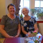 Ann and her Mum enjoying a meal.