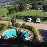 Camera con soppalco...veduta dal terrazzo..piscina