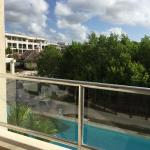 Some photos of a 1 bed suite seating area and balcony. Swim up pools look great and maintenance