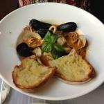 Zuppa de Mare (mussels, calamari, red snapper and fresh herbs in a light tomato broth)
