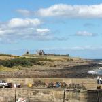 Dunstanburgh Castle in the distance