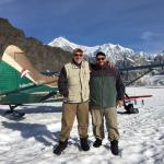 Ruth Glacier landing; father and son with Denali in the background.