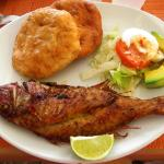 Fried whole fish with johnycakes, a traditional West Indian breakfast.