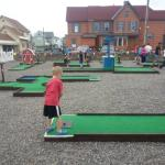 A kid at one of the holes