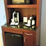 Coffee Center with fridge in room