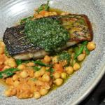 Barramundi, topped with salsav erde, on a bed of chickpea ragu.
