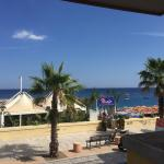 View of beach from 1st floor; hotel beach with free sun beds (small to medium large pebble stone