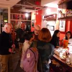 Party crowd at Cafe Foodelica for an art event. English is spoken here.