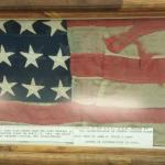 GAR civil war museum. This is the flag that was hanging from the balcony in Ford's Theater. Note