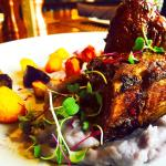Strauss lamb t-bone with purple Peruvian mashed potatoes, roasted heirloom carrots, and lamb dem