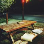 Sweet little picnic table set up complete with blankets in the cooler months