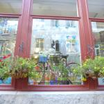 3 crows glass studio store front flower baskets