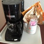 Outdated coffee maker & old coffee mug