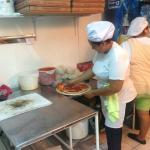Girls cooking the pizza
