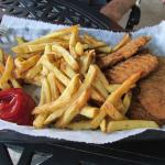 A healthy portion of chicken fingers and fries...
