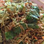 Green noodle salad with tofu all mixed up with some Sriracha sauce!!