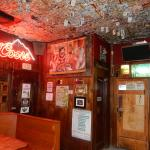 Dollar bills on the ceiling so you have money for your next beer.