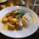 Chicken in a light cheese sauce with oven-roasted potatoes