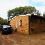 Back external view of the cottage with parking space & washing sink
