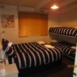 Bedroom 1 with Queen Bed & 2 Bunk Beds