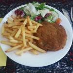 veg burger with chips and salad