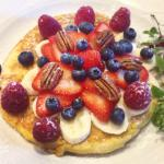 American pancake with berries, banana and pecans