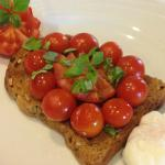 Tomato and Basil on wholemeal toast with poached egg